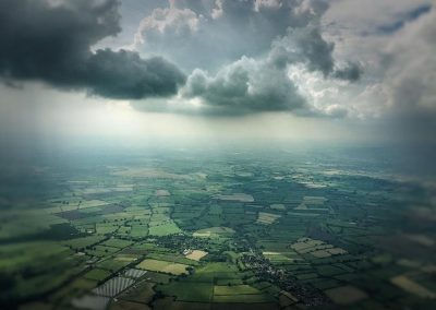 Copyright K. Alexander: View from the back seat. Dodging the thunder storms!